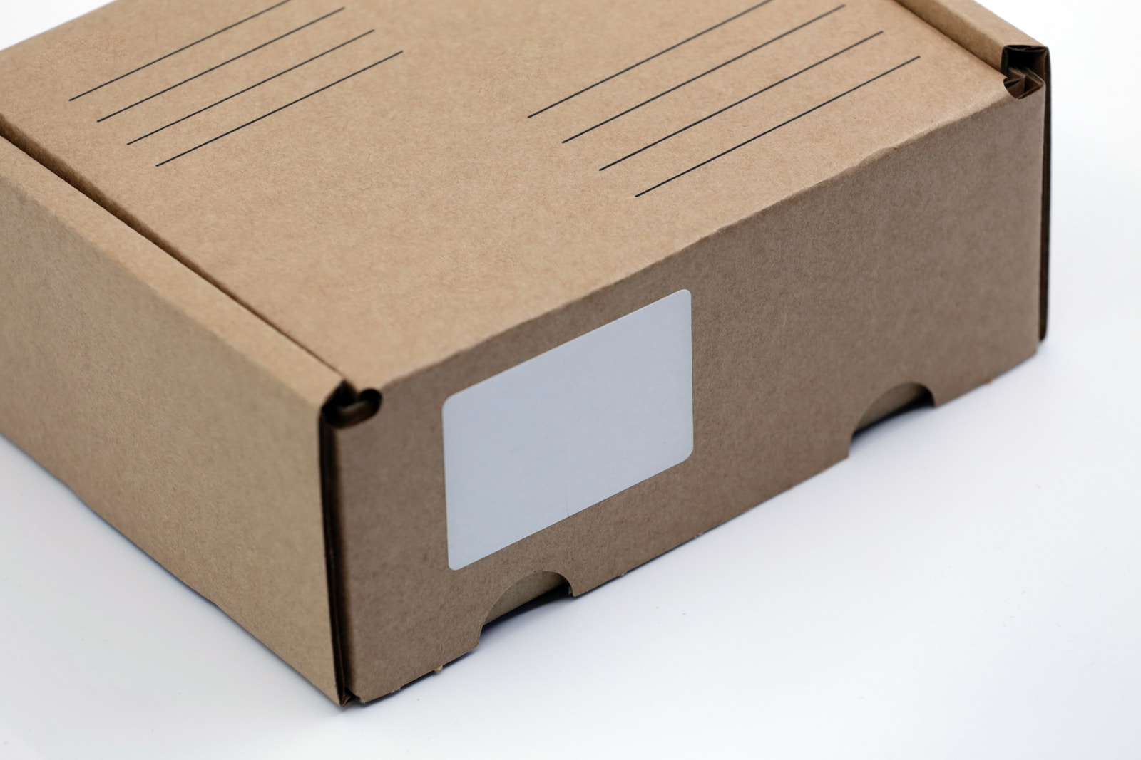 brown cardboard box on white table